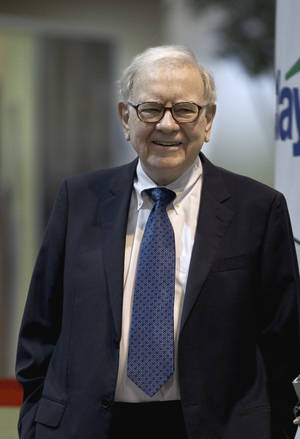 Photo -   In this May 5, 2012, photo, Warren Buffett, chairman and CEO of Berkshire Hathaway, smiles on the exhibit floor where Berkshire products are showcased, prior to the annual shareholders meeting in Omaha, Neb. Buffett appeared on CNBC Monday morning MAY 7, 2012. (AP Photo/Nati Harnik)