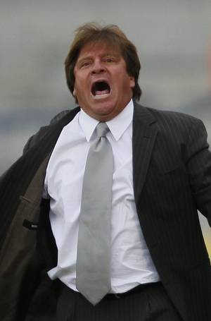 Photo - FILE - In this May 16, 2009 file photo, Tecos' soccer coach Miguel Herrera yells from the sidelines of a Mexican soccer league match against Pumas in Mexico City. Mexico's national soccer team named Herrera as its new coach on Friday, Oct. 18, 2013. (AP Photo/Claudio Cruz, File)
