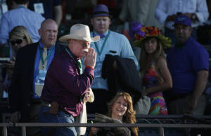 Photo - California Chrome co-owner Steve Coburn calls from the grandstand at Belmont Park after his horse finished fourth in the Belmont Stakes horse race, Saturday, June 7, 2014, in Elmont, N.Y. (AP Photo/Kathy Willens)