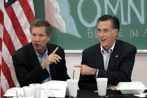 Photo -   FILE - In this April 27, 2012 file photo, Republican presidential candidate, former Massachusetts Gov. Mitt Romney, right, and Ohio Gov. John Kasich participate in a roundtable discussion in Westerville, Ohio. Kasich is doing what he can to help Romney win the battleground state _ and that sometimes includes holding his tongue. (AP Photo/Jae C. Hong, File)