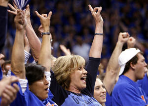 Photo - Connie Oswald, of Blanchard, Oklahoma, cheers for the Thunder during the first half of game 7 of the NBA basketball Western Conference semifinals between the Memphis Grizzlies and the Oklahoma City Thunder at the OKC Arena in Oklahoma City, Sunday, May 15, 2011. Photo by John Clanton, The Oklahoman