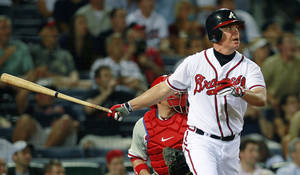 Photo -   Atlanta Braves' Chipper Jones follows through with a game-winning, two-run home run in the 10th inning of a baseball game against the Philadelphia Phillies in Atlanta, Wednesday, May 2, 2012. Atlanta won 15-13. (AP Photo/John Bazemore)