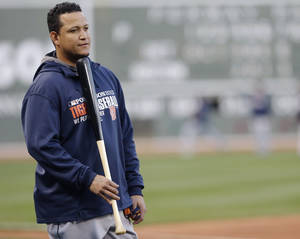 Photo - Detroit Tigers third baseman Miguel Cabrera waits to take the field before the baseball team's workout at Fenway Park in Boston, Friday, Oct. 11, 2013. The Tigers will face the Boston Red Sox in Game 1 of the American League championship series on Saturday. (AP Photo/Charlie Riedel)