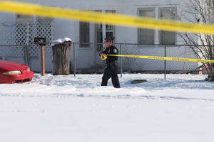 Photo - An Elk City woman was shot and killed on Wednesday morning, and her son was taken into police custody after police tased him in the snow. Photo by Derek Manning, Daily Elk Citian. <strong>Derek Manning - Derek Manning, Daily Elk Citian</strong>