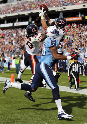 Photo -   Chicago Bears defenders Charles Tillman (33) and Chris Conte (47) break up a pass in the end zone intended for Tennessee Titans wide receiver Kenny Britt (18) in the second quarter of an NFL football game on Sunday, Nov. 4, 2012, in Nashville, Tenn. (AP Photo/Joe Howell)