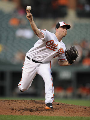 Photo -   Baltimore Orioles starting pitcher Steve Johnson delivers a pitch against the Seattle Mariners during the second inning of a baseball game, Wednesday, Aug. 8, 2012, in Baltimore. (AP Photo/Nick Wass)