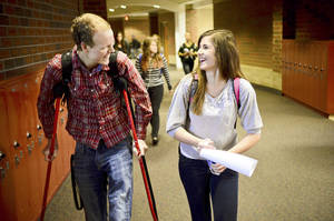 "Photo - Zach Sobiech, left, walks with his girlfriend, Amy Adamle, between classes at Stillwater High School in Stillwater, Minn., on Dec. 3, 2012. ""She's strong enough to share the load with me, said Sobiech. Sobiech, the Lakeland, Minn. teenager whose song ""Clouds"" became an Internet sensation, died early Monday, May 20, 2013 at his home, surrounded by family and his girlfriend, according to a CaringBridge post by Zach's mother. He was 18. Sobiech, who had a rare form of bone cancer, began writing songs of farewell to family and friends last fall. His first song, ""Clouds,"" went viral and has received almost 3 million hits on YouTube. (AP Photo/St. Paul Pioneer Press, Ben Garvin)"