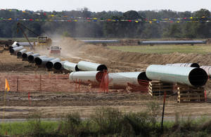 Photo - File - In this Oct. 4, 2012 file photo, large sections of pipe are shown in Sumner Texas. Safety regulators have quietly placed two extra conditions on construction of TransCanada Corp.'s Keystone XL oil pipeline after learning of potentially dangerous construction defects involving the pipeline's southern leg.  The new conditions were added four months after the pipeline safety agency sent TransCanada two warning letters about defects and other construction problems on the Keystone Gulf Coast Pipeline, which extends from Oklahoma to the Texas Gulf Coast. (AP Photo/Tony Gutierrez, file)