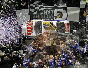 Photo - Dale Earnhardt Jr. celebrates in Victory Lane after winning the NASCAR Daytona 500 Sprint Cup series auto race at Daytona International Speedway in Daytona Beach, Fla., Sunday, Feb. 23, 2014. (AP Photo/John Raoux)