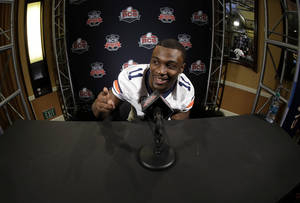 Photo - Auburn's Chris Davis answers a question during media day for the NCAA BCS National Championship college football game Saturday, Jan. 4, 2014, in Newport Beach, Calif. Florida State plays Auburn on Monday, Jan. 6, 2014. (AP Photo/David J. Phillip)