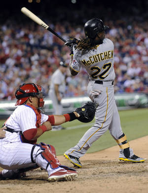 Photo -   Pittsburgh Pirates' Andrew McCutchen watches the ball go deep to right field for a two-run home run against the Philadelphia Phillies in the eighth inning of a baseball game Wednesday, June 27, 2012, in Philadelphia. The Pirates won 11-7. (AP Photo/Michael Perez)