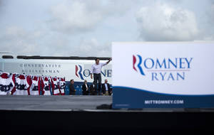Photo -   Republican presidential candidate, former Massachusetts Gov. Mitt Romney waves as he arrives for a campaign stop, Friday, Aug. 31, 2012, in Lakeland, Fla. (AP Photo/Evan Vucci)
