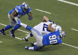 photo - Detroit Lions defensive tackle Ndamukong Suh (90) sacks Indianapolis Colts quarterback Andrew Luck (12) in the first quarter of an NFL football game at Ford Field in Detroit, Sunday, Dec. 2, 2012. (AP Photo/Carlos Osorio)