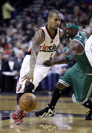 Photo - Portland Trail Blazers guard Eric Maynor, left, drives to the basket past Boston Celtics guard Jason Terry during the second half of an NBA basketball game in Portland, Ore., Sunday, Feb. 24, 2013.  Portland beat Boston 92-86.(AP Photo/Don Ryan)