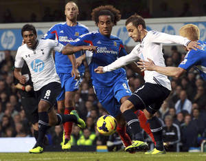 Photo - Tottenham's Roberto Soldado, right, is challenged with Hull City's Tom Huddlestone, centre, during their English  Premier League match at White Hart Lane, London Sunday Oct. 27, 2013.(AP Photo/Sean Dempsey/PA) UNITED KINGDOM OUT