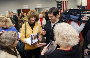Photo -   Matt Romney signs a book about his dad, Mitt Romney, for Nancy Eardley of Cascade Township on Monday, Nov. 5, at the Kent County Republican Headquarters. Grand Rapids was the first of several Michigan stops for Matt and his brother Josh. (AP Photo/The Grand Rapids Press, Emily Zoldaz) ALL LOCAL TV OUT; LOCAL TV INTERNET OUT