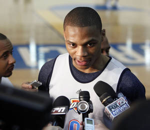 Photo - OKLAHOMA CITY THUNDER / DALLAS MAVERICKS / WESTERN CONFERENCE FINALS / NBA BASKETBALL PLAYOFFS: Russell Westbrook speaks to reporters during the Thunder's after practice media event at the Thunder practice facility in Oklahoma City, OK, Friday, May 20, 2011. By Paul Hellstern, The Oklahoman ORG XMIT: KOD