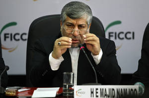 Photo -   Iranian Energy Minister Majid Namjoo speaks during an interactive business meeting with Federation of Indian Chambers of Commerce and Industry members in New Delhi, India, Wednesday, Oct. 10, 2012. (AP Photo/Altaf Qadri)
