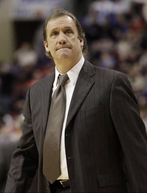 Photo - FILE - In this Jan. 13, 2012, file photo, then-Washington Wizards head coach Flip Saunders looks on during a break in an NBA basketball game against the Philadelphia 76ers in Philadelphia. David Kahn is out as president of basketball operations for the Minnesota Timberwolves and Flip Saunders is coming in. Three people with knowledge of the situation tell The Associated Press that team owner Glen Taylor has decided not to pick up the option for next season on Kahn's contract. He is also putting the finishing touches on a deal to hire Saunders as Kahn's replacement.(AP Photo/Matt Slocum, File)