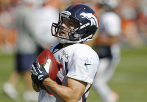 Photo - Denver Broncos wide receiver Wes Welker pulls in a pass during a morning session at the team's NFL training camp in Englewood, Colo., on Tuesday, Aug. 6, 2013. (AP Photo/David Zalubowski) ORG XMIT: CODZ112
