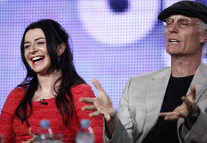 Photo - Actress Caterina Scorsone, left, laughs while listening to actor Matt Frewer speak in 2009  in Pasadena, Calif.  AP FILE