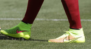 Photo - In this June 7, 2014 photo, Spain's Andres Iniesta wears his Nike Magista cleats during warm-up before an exhibition soccer game against El Salvador, in Landover, Md. Nike's fourth-quarter net income rose 5 percent as higher revenue offset heavy investments in marketing for the World Cup soccer tournament, the company reported Thursday, June 26, 2014. (AP Photo/Luis M. Alvarez, File)
