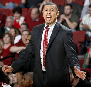 Photo - OU coach Jeff Capel shouts instructions in the NCAA college basketball game between the University of Oklahoma Sooners and Nebraska Cornhuskers at Lloyd Noble Center in Norman, Okla., Wednesday, Feb. 16, 2011. Photo by Bryan Terry, The Oklahoman
