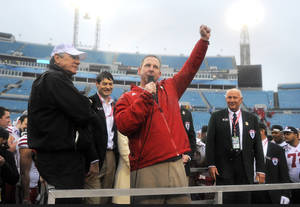 Photo - Nebraska head coach Bo Pelini celebrates on the riser after their 24-19 win over Georgia in the Gator Bowl NCAA college football game, Wednesday, Jan. 1, 2014, in Jacksonville, Fla.  (AP Photo/Stephen B. Morton)