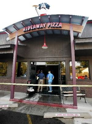 Photo - Front entrance to Hideaway Pizza, 6616 N Western Ave., as damage is being inspected after an early morning fire at the popular pizza establishment in Oklahoma City Tuesday, Sept. 25, 2012. Photo by Paul B. Southerland