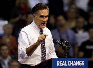 """Photo -   FILE - In this Nov. 5, 2012, file photo, Republican presidential candidate, former Massachusetts Gov. Mitt Romney speaks at a campaign event at the Verizon Wireless Arena in Manchester, N.H. Romney is telling top donors that President Barack Obama won re-election because of the """"gifts"""" he had already provided to blacks, Hispanics and young voters. Romney also cites as a reason for his loss the president's effort to paint Romney as anti-immigrant. In a call Wednesday, Nov. 14, 2012, to those donors, Romney said Obama's campaign focused on giving targeted groups what he called """"a big gift"""" while his campaign had been about, in his words, """"big issues for the whole country."""" (AP Photo/David Goldman, File)"""