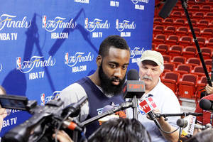 photo - Oklahoma City's James Harden, center, listens to a question from the media before a practice for Game 5 of the NBA Finals on Wednesday. Photo by Bryan Terry, The Oklahoman