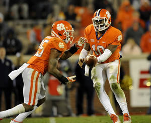 Photo - Clemson quarterback Tajh Boyd hands the ball off to Roderick McDowell during the second half of an NCAA college football game Thursday, Nov.14, 2013, at Memorial Stadium in Clemson, S.C. Clemson won 55-31. (AP Photo/ Richard Shiro)
