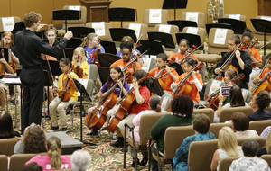 Photo - The El Sistema Oklahoma youth orchestra performs its final concert of the school year at St. Luke's United Methodist Church, 222 NW 15.  Photo by Doug Hoke,  The Oklahoman <strong>DOUG HOKE -   </strong>
