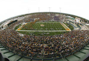 Photo - FILE - In this Oct. 23, 2010 file photo, Baylor and Kansas State fans fill Floyd Casey stadium after heavy rain and lighting forced a delay of their NCAA football game, in Waco, Texas. Baylor plays its final game at Floyd Casey Stadium Saturday, Dec. 7, 2013, after 64 seasons.(AP Photo/Waco Tribune Herald, Jose Yau, File)