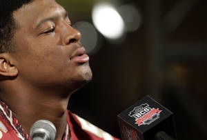 Photo - Florida State's Jameis Winston answers a question during media day for the NCAA BCS National Championship college football game Saturday, Jan. 4, 2014, in Newport Beach, Calif. Florida State plays Auburn on Monday, Jan. 6, 2014. (AP Photo/Chris Carlson)