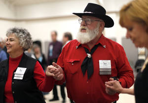 Photo - Angel and Bill Baker dance during a Teacup Chains square dance in Edmond in January. The Bakers are helping plan the 62nd National Square Dance Convention that gets underway later this month in Oklahoma City.  Photo by Sarah Phipps, The Oklahoman <strong>SARAH PHIPPS - SARAH PHIPPS</strong>