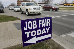 Photo - In this April 10, 2014, photo, a sign points to a job fair on the campus of Kaplan University in Lincoln, Neb.  At first glance, April's U.S. employment report suggested that the agonizingly slow 5½-year-old economic recovery has gained new momentum. Yet several cautionary signs emerged from the report. (AP Photo/Nati Harnik)