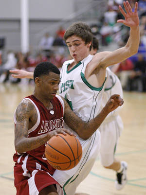 Photo - Ardmore's Nino Jackson tries to get past Dean Fitzpatrick of Bishop McGuinness  during a high school basketball game at Bishop McGuinness in Oklahoma City, Tuesday, Feb. 15, 2011.  Photo by Bryan Terry, The Oklahoman ORG XMIT: KOD