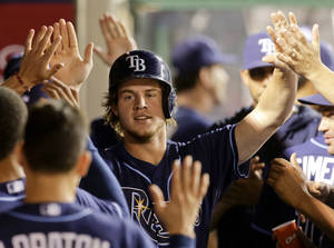 Photo - Tampa Bay Rays' Wil Myers celebrates a home run against the Los Angeles Angels during the second inning of a baseball game in Anaheim, Calif., Wednesday, Sept. 4, 2013. (AP Photo/Chris Carlson)