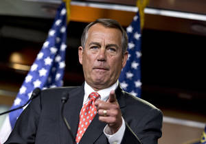 "photo - House Speaker John Boehner of Ohio gestures as he speaks to reporters on Capitol Hill in Washington, Thursday, Nov. 29, 2012, after private talks with Treasury Secretary Timothy Geithner on the fiscal cliff negotiations. Boehner said no substantive progress has been made between the White House and the House"" in the past two weeks.  (AP Photo/J. Scott Applewhite)"