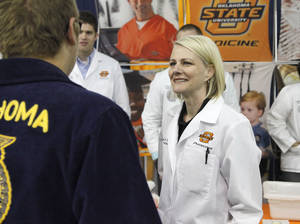Photo -  Kayse Shrum, president of the OSU Health Sciences Center, speaks to students at a recent FFA event at the Cox Convention Center about going into medicine.  Photo by Paul Hellstern, The Oklahoman  <strong>PAUL HELLSTERN -  Oklahoman </strong>
