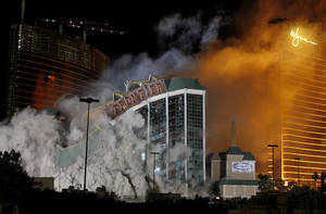 Photo - FILE - In this Nov. 13, 2007 file photo The New Frontier Hotel & Casino located on the Las Vegas Strip is imploded. A new resort could soon spring up on the vacant site of the former New Frontier casino, thanks to a partnership between Australian billionaire James Packer and former Wynn Las Vegas President Andrew Pascal. (AP Photo/Isaac Brekken, File)