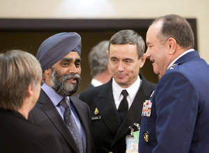 Canadian Defense Minister Harjit Singh Sajjan, second left, speaks with Supreme Allied Commander Europe, Gen. Philip Breedlove, right, during a meeting of the North Atlantic Council at NATO headquarters in Brussels on Wednesday, Feb. 10, 2016. NATO defense ministers convene a two-day meeting to discuss current defense issues and whether the Alliance should take a more direct role in dealing with its gravest migrant crisis since WWII. (AP Photo/Virginia Mayo)