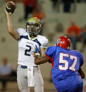 Photo - Heritage Hall's Quinn Shanbour throws  during a high school football game against John Marshall at Taft Stadium in Oklahoma City, Thursday, Oct. 13, 2011, Photo by Bryan Terry, The Oklahoman ORG XMIT: KOD