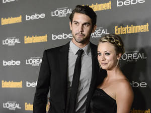 Photo - FILE - This Sept. 20, 2013 file photo shows actress Kaley Cuoco, right, and Ryan Sweeting at the 2013 Entertainment Weekly Pre-Emmy Party in Los Angeles. After a quick courtship, Cuoco is engaged to tennis pro Ryan Sweeting, her rep confirms. The 27-year-old actress and 26-year-old Sweeting began dating about three months ago. (Photo by Dan Steinberg/Invision/AP, File)