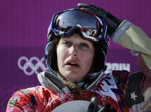Photo - Lindsey Jacobellis  of the United States reacts after winning the small final of the women's snowboard cross at the Rosa Khutor Extreme Park, at the 2014 Winter Olympics, Sunday, Feb. 16, 2014, in Krasnaya Polyana, Russia. (AP Photo/Andy Wong)
