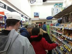 photo - More than two dozen people waited on line at the Walgreens at 2nd Street and Santa Fe in Edmond about 6 p.m. tonight in anticipation of yet another major winter storm. A pharmacy technician at the store reported lines crowds Tuesday were even bigger than they were before last week&#039;s winter storm. Photo by Steve Lackmeyer