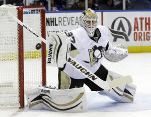 Photo - Pittsburgh Penguins goalie Jeff Zatkoff (37) stops a shot on the goal during the second period of an NHL hockey game against the New York Islanders, Thursday, Jan. 23, 2014, in Uniondale, N.Y. (AP Photo/Frank Franklin II)