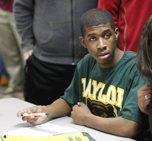 Photo - Edmond Memorial Isaiah Duke signing with Baylor track, Wednesday, February 1, 2012.Photo by David McDaniel, The Oklahoman