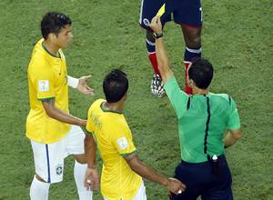 Photo - Brazil's Thiago Silva gets a yellow card during the World Cup quarterfinal soccer match between Brazil and Colombia at the Arena Castelao in Fortaleza, Brazil, Friday, July 4, 2014. (AP Photo/Fabrizio Bensch, pool)